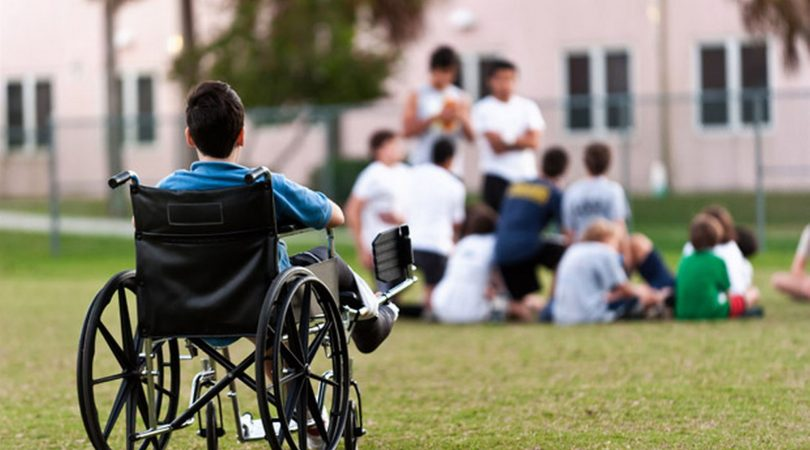 child-in-a-wheelchair-with-his-leg-raised-776479